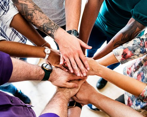 resized-group-of-diverse-people-joined-hands-together-RP8JXS5 (1)