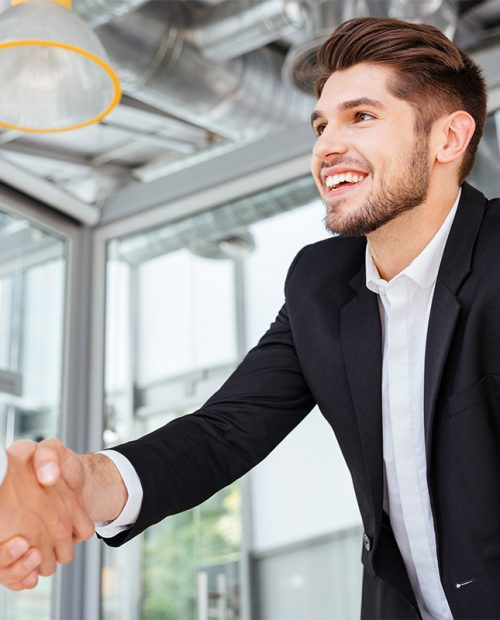 resized-two-successful-businessmen-shaking-hands-on-PQF3VFU